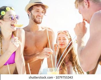 Happy friends drinking tropical cocktail in boat party outdoor - Young people having fun on summer vacation - Youth lifestyle, friendship,  travel and holidays concept - Focus on left man face