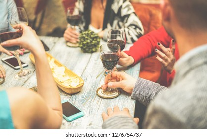 Happy friends drinking wine inside vintage trendy bar - Fashion people having fun at appetizer evening - Youth, friendship, party and trends concept - Focus on bottom right hand