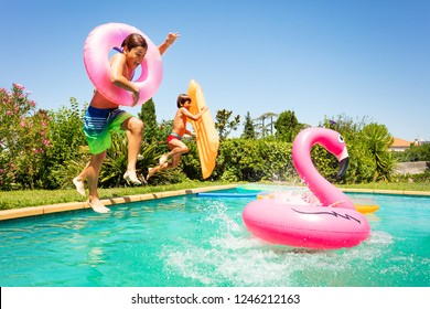Happy friends enjoying pool party in summer