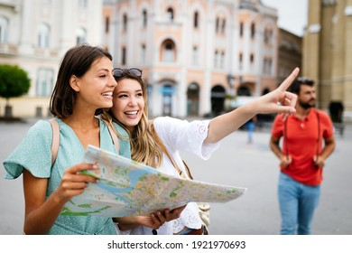 Happy friends enjoying sightseeing tour in the city. - Shutterstock ID 1921970693