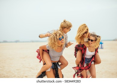Happy friends enjoying summer vacation together.
