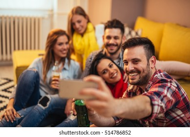 Happy friends enjoying time together and making a selfie.
