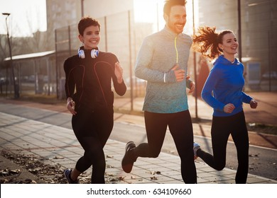 Happy friends fitness training together outdoors living active healthy lifestyle
