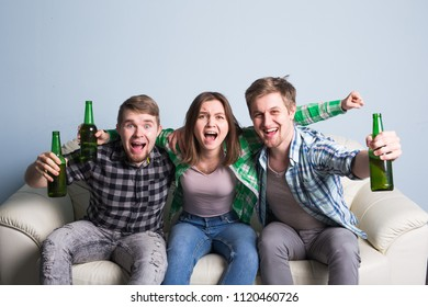 Happy friends or football fans watching soccer on tv and celebrating victory. Friendship, sports and entertainment concept
