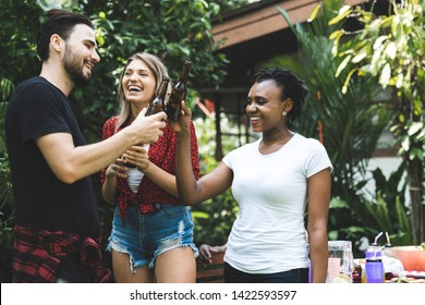 Happy friends fun at in the backyard - Young people camping at summer outdoor party and holidays  - Youth friendship concept with guys and girls drinking wine at barbecue party