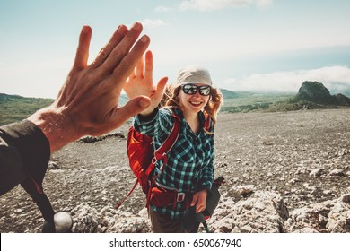 Happy Friends giving five hands traveling at mountains Travel Lifestyle positive emotions concept. Young couple together active adventure vacations
