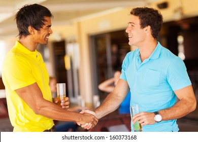 happy friends handshaking at the party