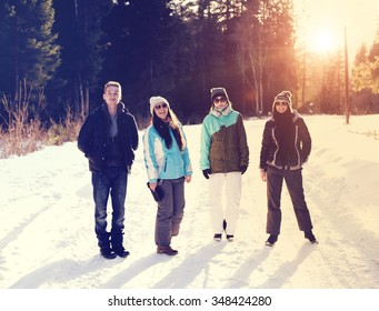 happy friends have fun at winter on fresh snow, healthy young people group outdoor.