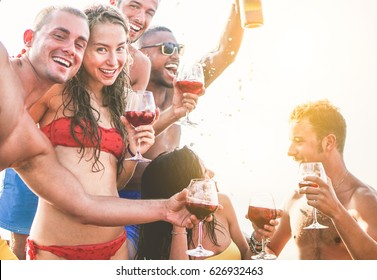 Happy friends having a boat party outdoor with sangria and champagne