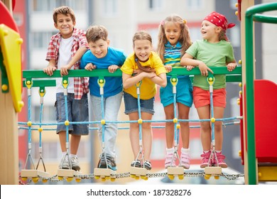 Happy friends having fun on playground