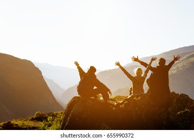 Happy friends having fun at sunset time in mountains range backdrop. Space for text