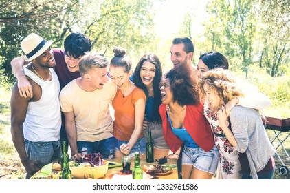 Happy friends having fun together at pic nic barbecue party - Young millenial people at picnic on open air festival - Youth friendship concept with guys and girls cheering at barbeque - Bright filter