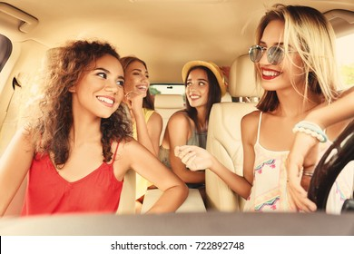 Happy friends having fun together in car