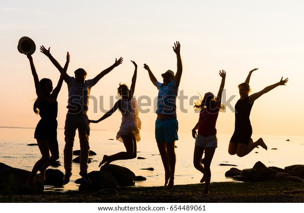 Happy friends having a party on a beach. Young, freedom, beach, summer, concept.