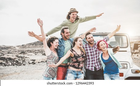 Happy friends making story for social network app around desert - Young people having fun with new technology trends - Travel, tech, vacation tour and friendship concept - Focus on faces