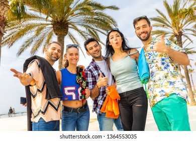 Happy friends on seaside walk in Barcelona - Multiracial group of best friends enjoying summer and time together - Happiness and friendship during a travel in Spain