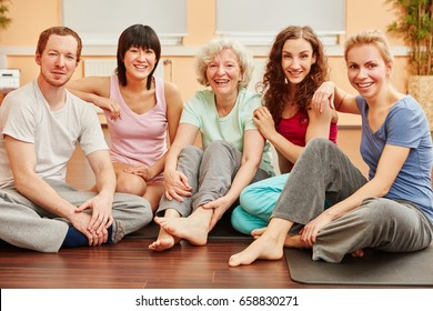 Happy friends and senior woman at fitness center