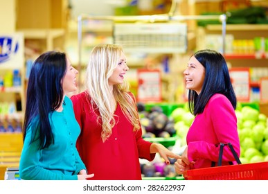 happy friends shopping together in grocery supermarket