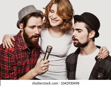 Happy friends singing karaoke together