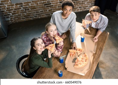 happy friends spending time together with pizza and soda drinks, eating pizza at home concept