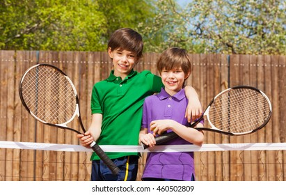 Happy friends standing together after tennis match