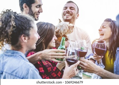 Happy friends taking selfie during party dinner at home backyard - Group of young people having fun with trends technologies - Focus on right man  - Youth, friendship, summer, youth lifestyle concept