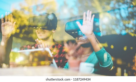 Happy friends using virtual reality goggles in modern coworking space - Window reflection view - Millennials people having fun with vr technology - Future and digital concept - Focus on girl mouth