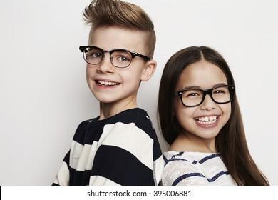 Happy friends wearing glasses in studio