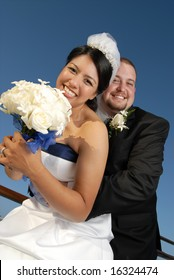 Happy, fun couple on their wedding day