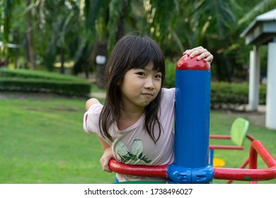 Happy Fun Cute Child girl asian play on the playground in holiday