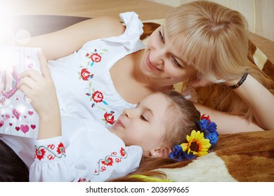 happy funny beautiful mother and little  charming daughter