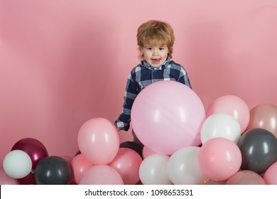 Happy funny child, boy on birthday party. Cute boy with the child's tongue sticking out. A keen emotional child, children's interest, a fun game for children, a children's entertainment center