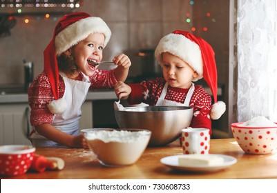 happy funny children bake christmas cookies