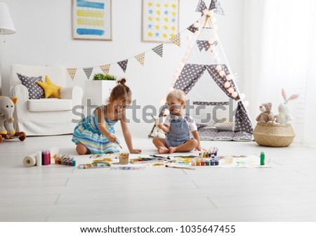 a happy funny children paint with paint