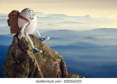 Happy funny egg hiker sitting on a cliff and enjoy the mountain valley. Travel concept.