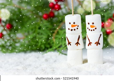 Happy funny marshmallow snowman on the background of Christmas tree