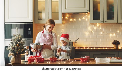 happy funny mother and child  son bake christmas cookies