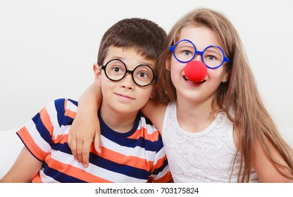 Happy and funny young siblings. Children preparing for carnaval.