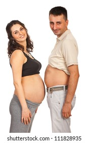 Happy future parents standing with their bellys  face to face isolated on white background