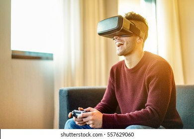 9fd16f0e3887 Happy gamer man playing video games virtual reality glasses in his  apartment - Young person having