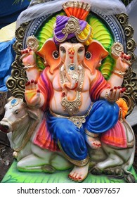 Happy Ganesh Chathurthi. Indian Hindu God Lord Ganesha Statue made of clay and coated with ceramic colors, handmade artistic effects, Beautiful artifacts. He also known as Lord Vinayaka.
