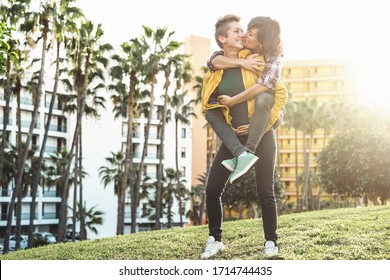 Happy gay couple dating day - Young lesbians women having tender romantic moments together outdoor - Lgbt lifestyle and homosexuality love relationship concept