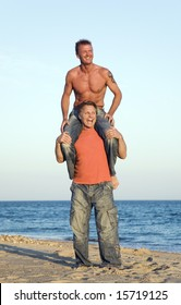 A happy gay couple are enjoying their vacation on the beach.