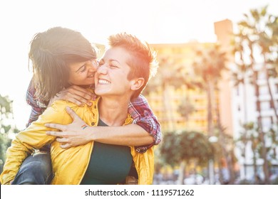 Happy gay couple having fun together outdoor - Young millennials women having a date - Equality right, homosexuality lifestyle, lgbt, and relationship concept - Focus on right girl face