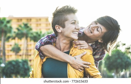 Happy gay couple having fun together outdoor - Young women having a date - Equality right, homosexuality lifestyle, lgbt, and relationship concept - Focus on left girl - Soft contrast filter