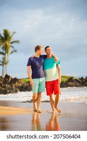 Happy gay couple on the beach