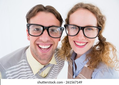 Happy geeky hipster smiling at camera on white background