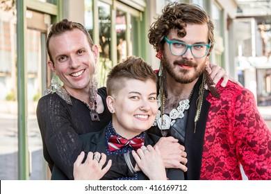 Happy gender fluid trio of young friends