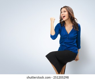 Happy gesturing young cheerful smiling businesswoman, with copyspace area