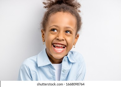 happy girl, african child girl isolated over white background. emotional cheerful little girl with excited expression face, laugh and look up
